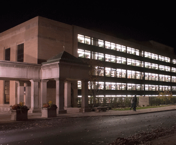 Nighttime image of the Patee and Paterno library with lights on.