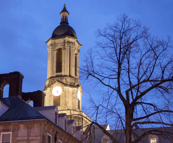 Night view of the Old Main bell tower on the University Park campus.