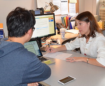 A student working with an adviser.