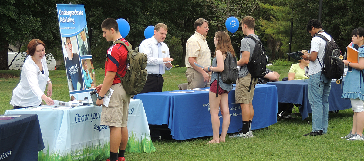 Students talking to members of various colleges at the 2014 DUS College Fair in East Halls.