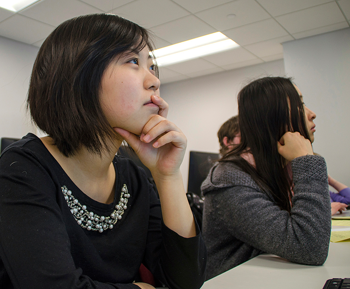 Students listening during a class lecture.