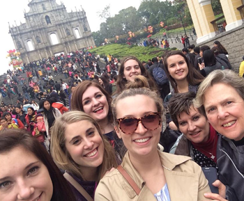 Students taking a group picture while in Europe studying abroad.