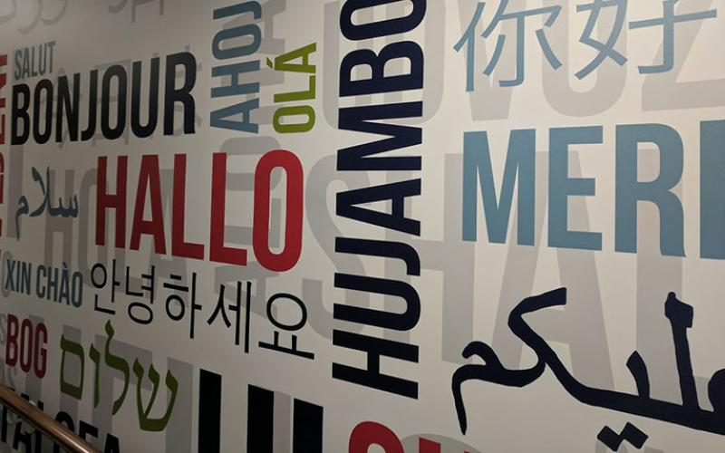 Welcome Wall in Grange Building with the word Hello written in many languages.